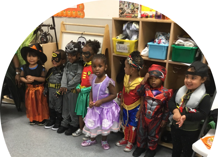 childrens wearing halloween costumes