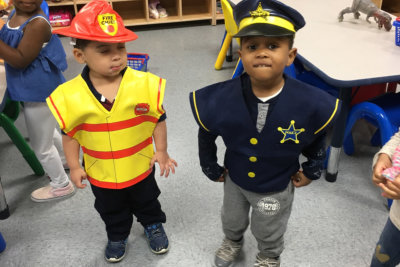 two kids in costumes